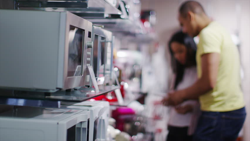 4K Couple shopping in a store selling kitchen appliances, white goods & electronic | Shutterstock HD Video #8984014