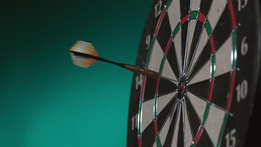 Dart hits bullseye & Dart bounces off board, slow motion; shot on Phantom Flex 4K at 1000 fps