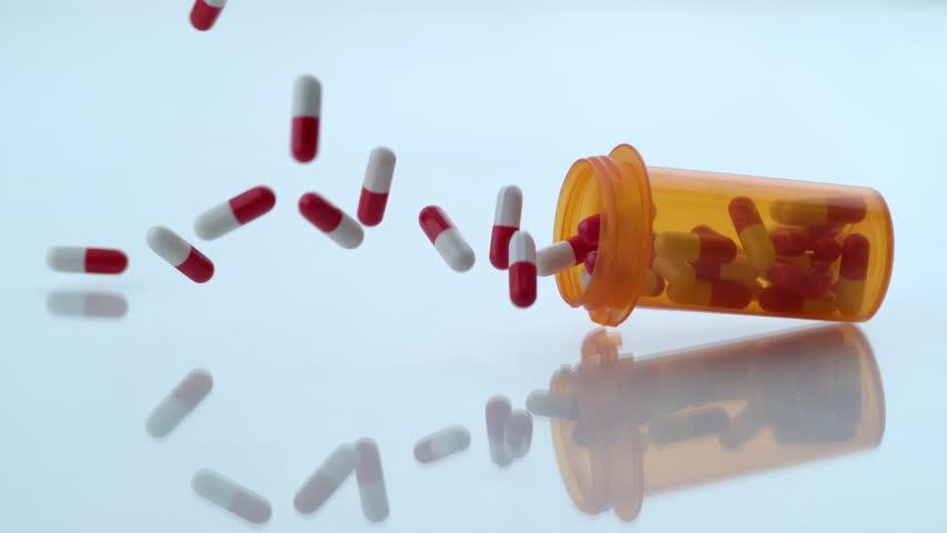 Pills spilling out of bottle in slow motion; shot on Phantom Flex 4K at 1000 fps | Shutterstock HD Video #8988085