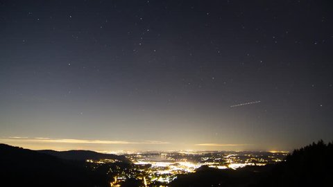 time lapse of stars spinning over the city of Issaquah Washington as the city glows throughout the night.