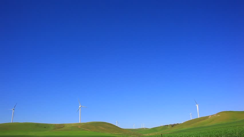 Windmills under deep blue sky
