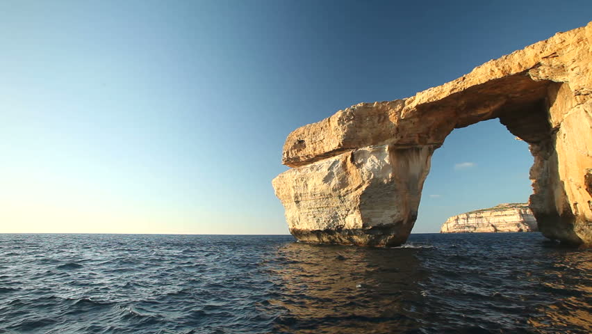 Pan shot view of Azure Window, known as Tieqa erqa, a natural rock formation on the coast of Gozo island, Malta
