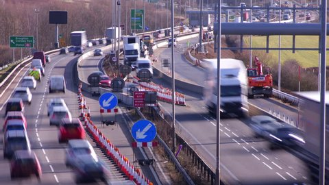 Northamptonshire, UK - March 02, 2015: Time lapse of road traffic flowing through a contraflow at the almost complete road widening road works on the A14 dual carriageway.