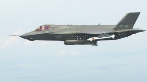 CIRCA 2010s - An F-35 Lightning drops bombs from a high altitude.