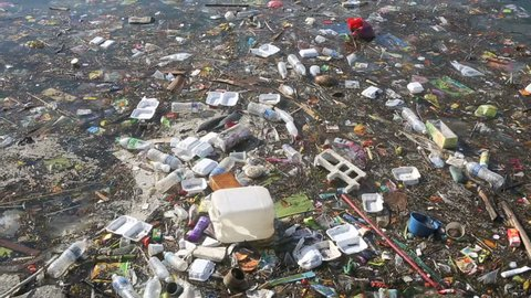 Plastic bottles and other trash floating in ocean