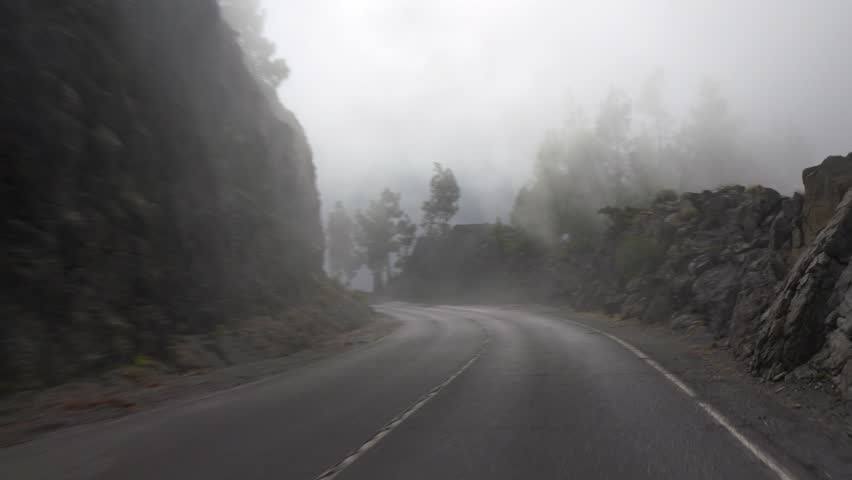 4K. POV. Driving on mountain misty road, Tenerife, Canary islands.