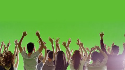 Crowd of fans dancing on green screen. Concert, Jumping, Dancing, Hands up. Slow motion. Shot on RED EPIC Cinema Camera.