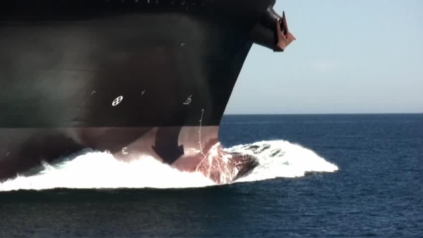 Bow area of a container ship with the bulb breaking sea