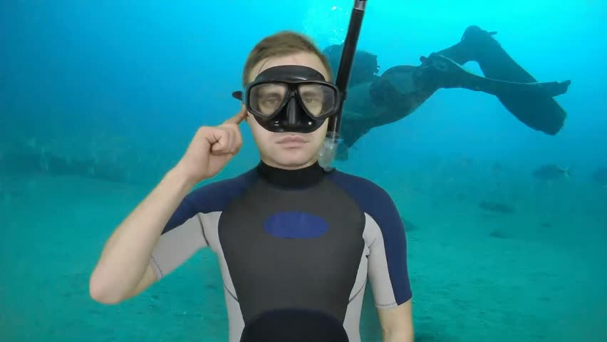 Diving sign- divemaster  shows sing  TROUBLE WITH EAR,  I CAN NOT EQUALIZE PRESSURE   ,also a available on the green screen all of diving sings from course (open water diver) 1 0F 3