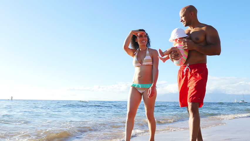 4k0029Black Family Walking On The Beach Together