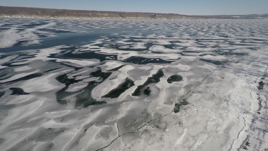 4K Aerial shot of snow covered Cayuga lake in winter | Shutterstock HD Video #9211085