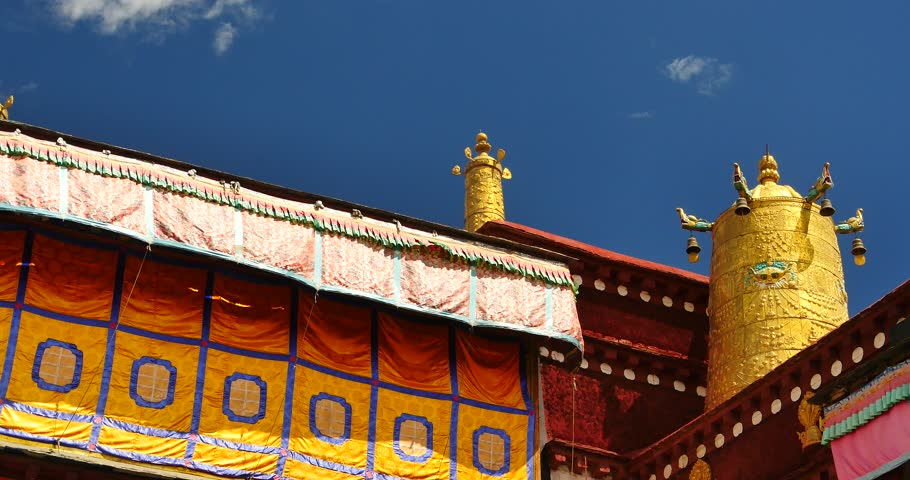 4k closeup of The Jokhang Temple In Lhasa,Tibet,white clouds in blue sky. gh2_09655_4k
