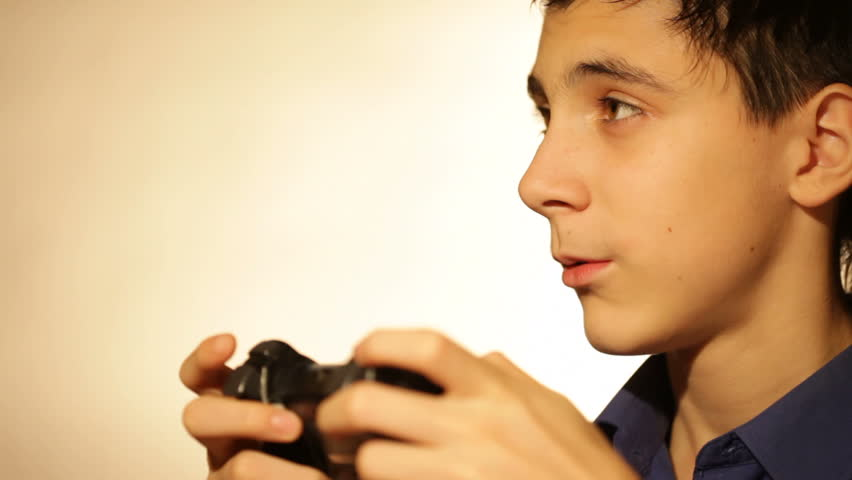 boy with games console playing video game.