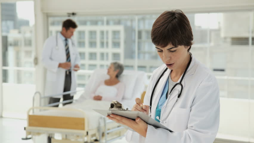 Young Doctor Writing A Prescription In A Hospital Stock Footage ...