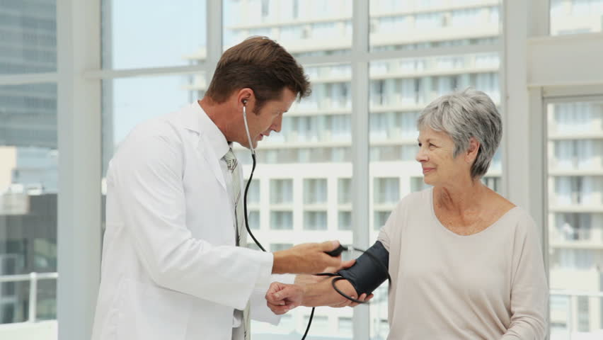 Doctor Checking Blood Pressure of a Senior Woman