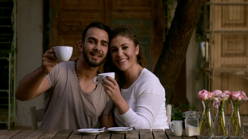 Dating couple smiling at camera while at coffee cafe. - 4K stock video clip