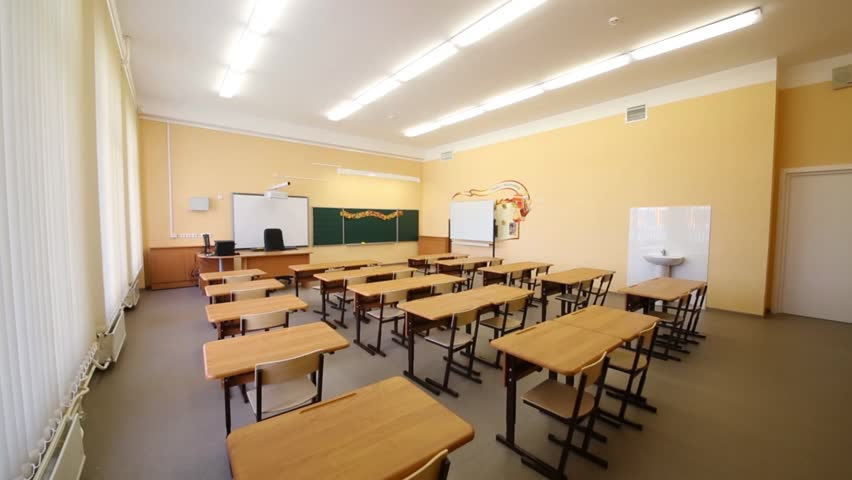 Modern Classroom Desks ~ New modern school classroom with chairs on desks at sunny