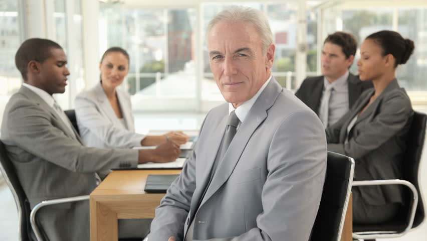 Businessman Posing at a Meeting