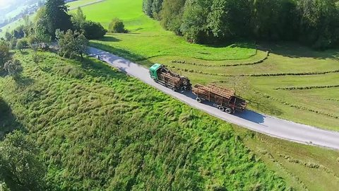 timber truck aerial view. timber truck on a pass in the alps of Austria, with plenty of wood