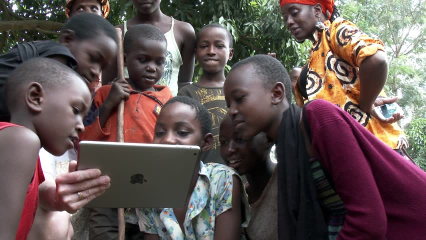 KIGALI, RWANDA JANUARY 2015: African children see a tablet for the first time