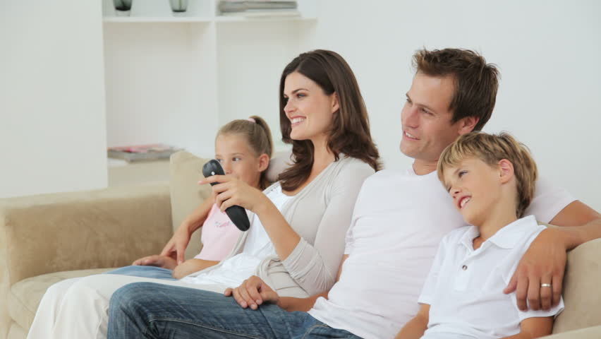 Young Family of Four Watching TV