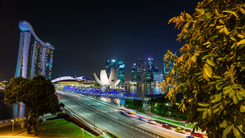 SINGAPORE, SINGAPORE - october 2014: traffic road night light famous marina bay sands hotel 4k time lapse circa october 2014 singapore, singapore.