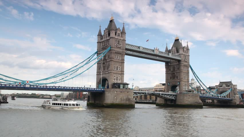 Excursion boat slowly going under magnificent Tower Bridge in London