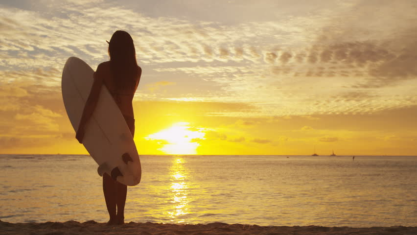 aa23e266a5 Surfer girl surfing looking at ocean beach sunset. Silhouette of female  bikini woman looking at water with standing with surfboard having fun  living healthy ...