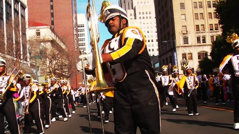 SHREVEPORT, LA/USA - JANUARY 19, 2015: Marching band plays at The 'Krewe of Harambee Mardi Gras Parade,' which is held annually on Martin Luther King Jr Day. 1080p HD.