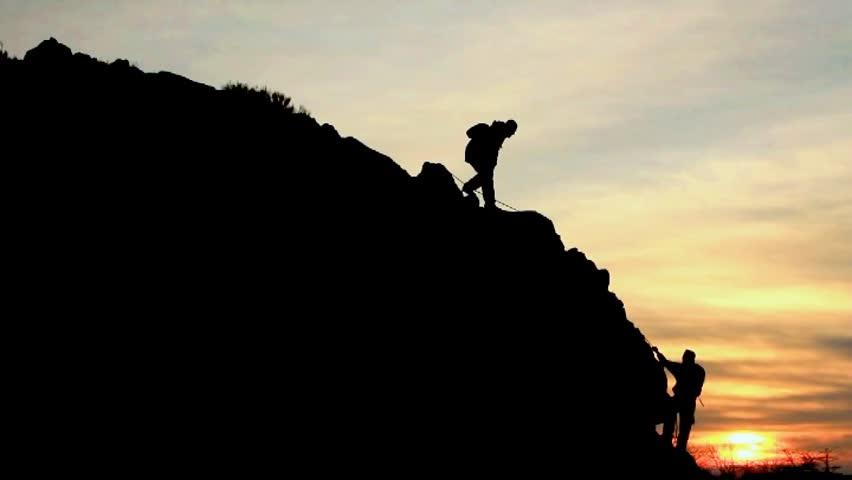 climbing help silhouette | Shutterstock Video #9431681