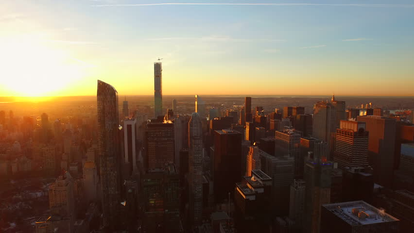 New York City Aerial v86 Flying low over Midtown Manhattan buildings towards beautiful sunrise. 3/13/15