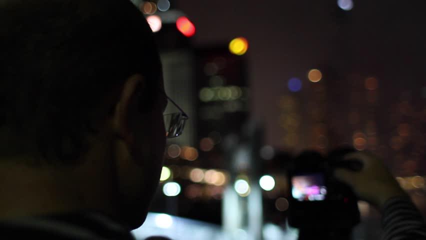 A photographer photographs a fireworks display in Brisbane, Australia | Shutterstock HD Video #9482315