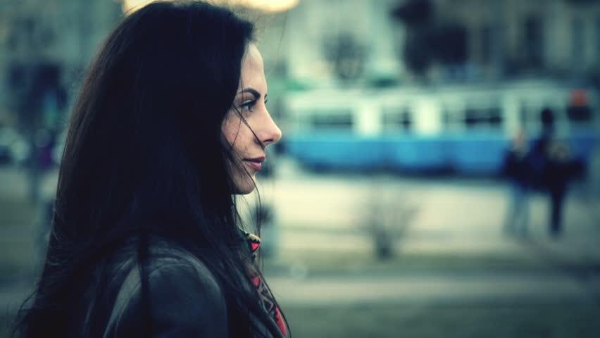 Portrait of a beautiful young girl closeup. Caucasian, beautiful young girl looking at the camera. Portrait of a young girl on a city street. Girl, city, street.   Shutterstock HD Video #9490985