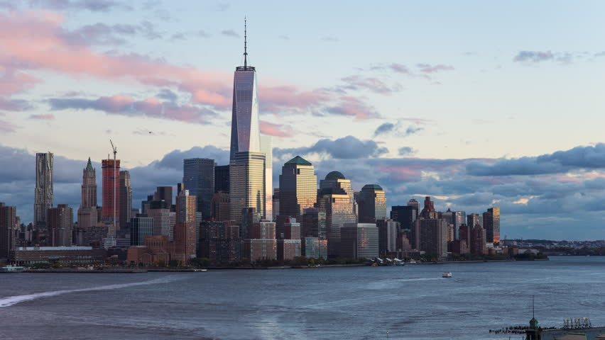 New York - CIRCA NOVEMBER 2014: One World Trade Center and Downtown Manhattan across the Hudson River, time-lapse