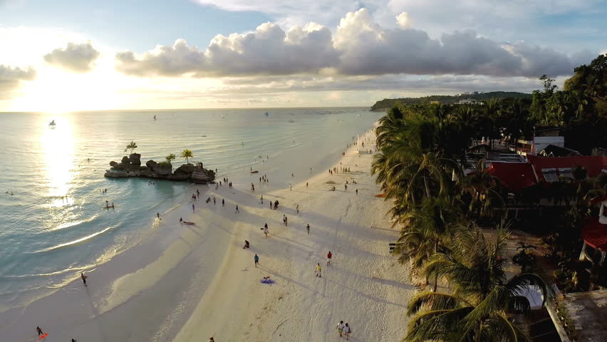 Aerial flight above white beach and Willy's Rock at Boracay Beach