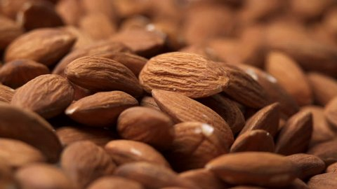 Hand taking almonds in slow motion. Find similar clips in our portfolio.