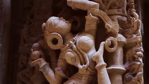 Sandstone sculptures of a Jain temple in Jaisalmer, Rajasthan, India. Panning shot with shallow depth-of-field.