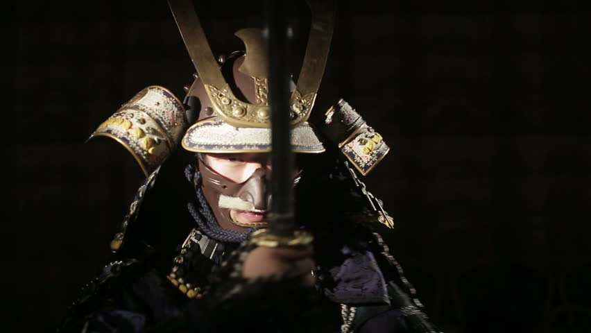 samurai with a sword comes out from the darkness