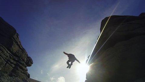 Super Slow Motion - Man Jumps Off Rocks 03