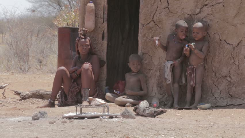 NAMIBIA, KAMANJAB, OCTOBER 10: Himba tribe woman with childs, in the village of Himba people  near Kamanjab in northern Namibia, October 10, 2014, Namibia
