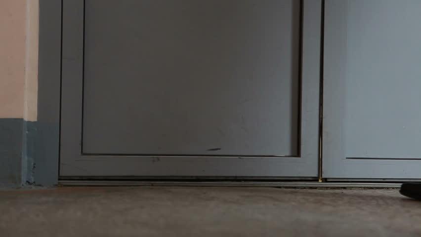 Close-up of people entering of the door   Shutterstock HD Video #964321