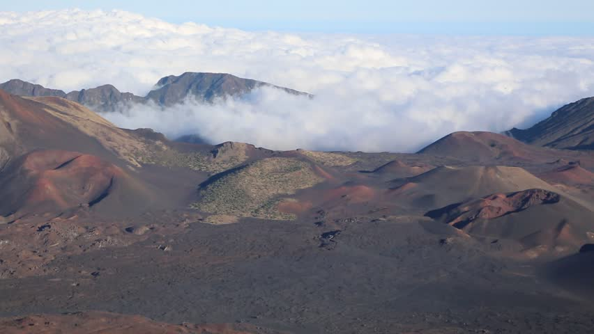 Cones in haleakala national park maui hawaii stock footage video haleakala crater over clouds haleakala national park maui hawaii hd stock footage publicscrutiny Image collections
