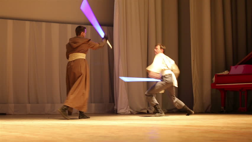 MOSCOW, RUSSIA - MARCH 28, 2015: Star Wars Cosplay show. Jedi lightsaber battle on the stage during the festival Star Fans.