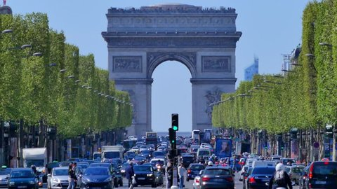 Traffic on Champs-Elysees with Arc de Triomphe in background, Paris, France
