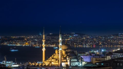 ISTANBUL - APRIL 03: Panoramic Time Lapse scene of the New Mosque in Istanbul with boat traffic in background by night. Time-Lapse in 4K. April 03, 2015 in Istanbul, Turkey.
