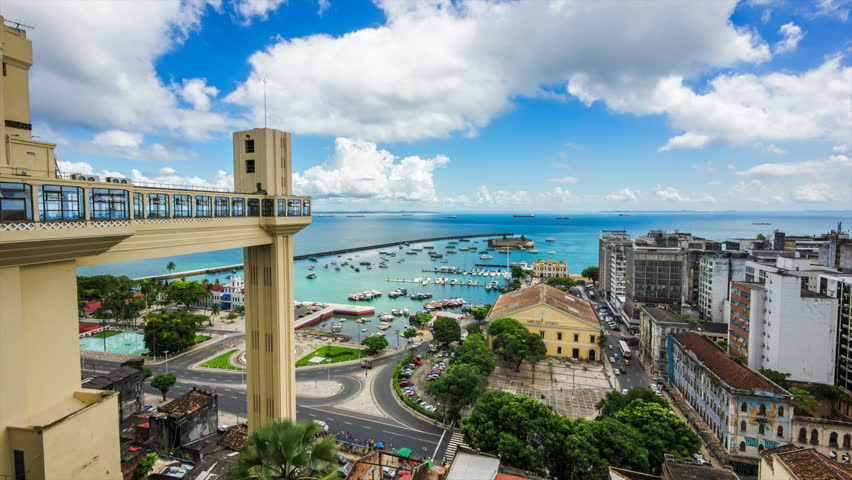 Salvador da Bahia, Brazil, time lapse view of Lacerda Elevator and All Saints Bay (Baia de Todos os Santos) on a beautiful summer day.