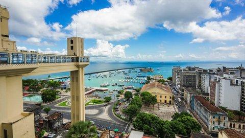 Salvador da Bahia, Brazil, time lapse view of Lacerda Elevator and All Saints Bay (Baia de Todos os Santos) on a beautiful summer day.