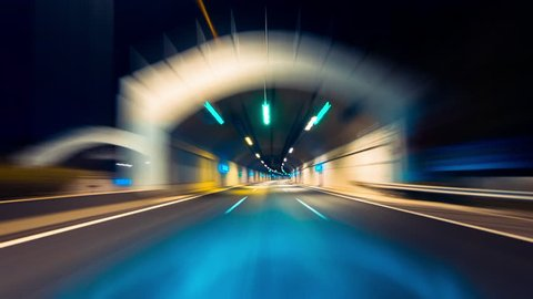 4K-HD drive pov modern highway timelapse/hyperlapse night.Pov night driving hyperlapse at a modern highway passing a series of tunnels.Camera is placed outside the vehicle and level is horizontal.