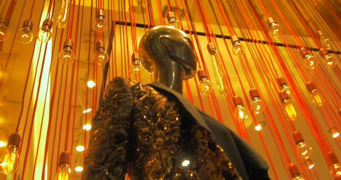 Female mannequins inside a fashion house showcase