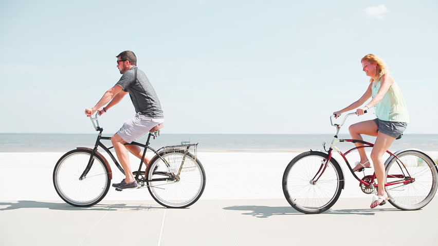 A Riding Bikes At The Beach Hd Stock Footage Clip